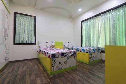 Total Interior design work in Wakad, Pune:  Girls Bedroom by Designaddict