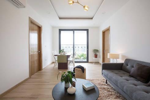Căn hộ chung cư này có diện tích 71m2 của một gia đình gồm 3 thành viên.:  Phòng khách by Công ty TNHH Thiết Kế Xây Dựng Song Phát