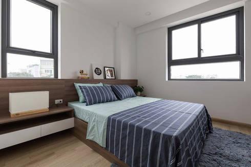 Một bộ giường liền khối với bàn sẽ là lựa chọn tối ưu cho những căn chung cư hiện đại.:  Phòng ngủ by Công ty TNHH Thiết Kế Xây Dựng Song Phát