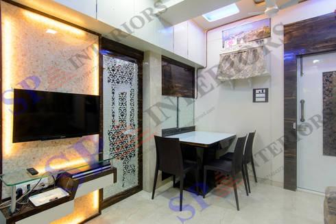 Mr.Ritesh: modern Dining room by SP INTERIORS