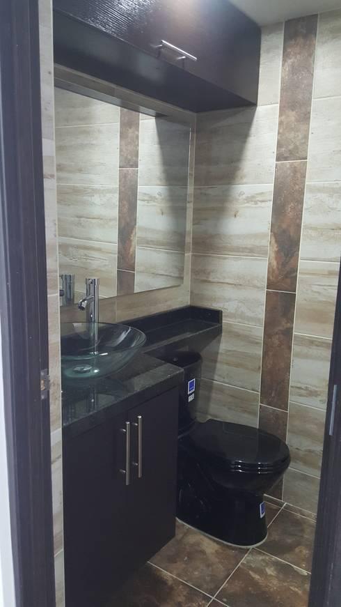 Diseño de interiores cojunto Fortezza Ibagué – Tolima: Baños de estilo moderno por LH INGENIERÍA 'Construcciones para la Vida'