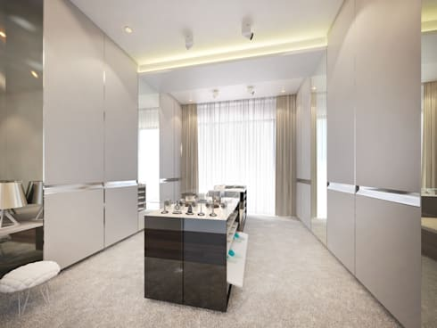 Walk-in closet: modern Dressing room by Dessiner Interior Architectural