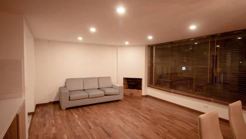 Apartamento Angarita Yañiez: Salas de estilo moderno por AMR estudio