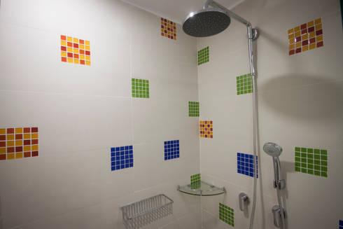 Apartamento Angarita Yañiez: Baños de estilo moderno por AMR estudio