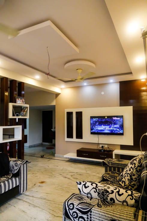 Mr. KoteshwarRao Uppal: modern Living room by Ghar Ek Sapna Interiors