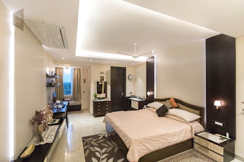 Ambience Lagoon: eclectic Bedroom by UK Interia Pvt Ltd