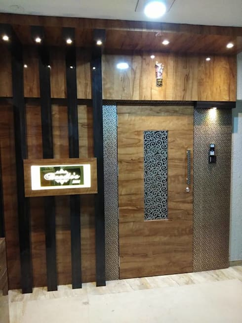 main door:  Doors by KUMAR INTERIOR THANE