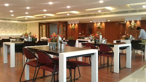 Cafeteria Design for HPCL at Scope Minar Office: modern Dining room by HOME CITY LIFESTYLE