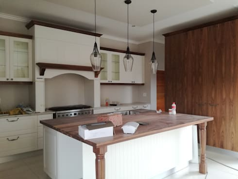 Off white and walnut solid wood:  Built-in kitchens by Première Interior Designs