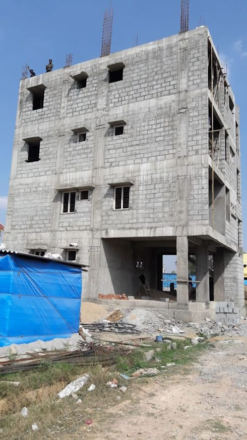 Block-work is in progress:  Multi-Family house by Cfolios Design And Construction Solutions Pvt Ltd