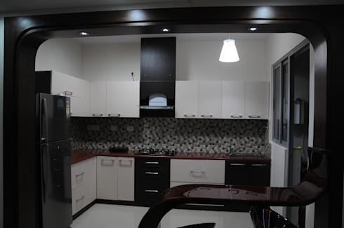 interiors : modern Kitchen by Home  Solutions