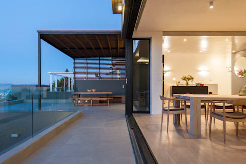 Patio with steel pergola and timber roof:  Patios by JBA Architects