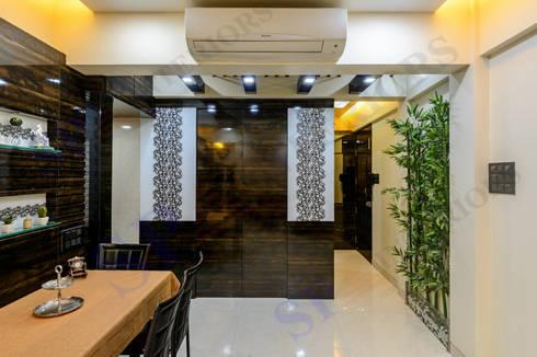 VarunJhaveri: modern Living room by SP INTERIORS