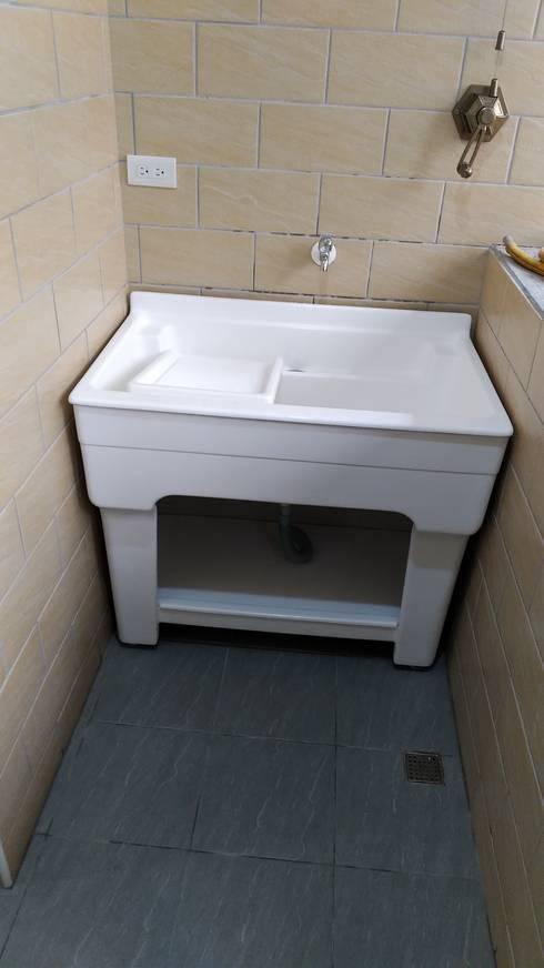 一體型人造大理石洗衣槽:  陽台、門廊與露臺 by 綋宜實業有限公司