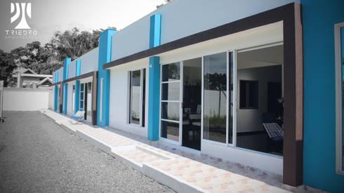 UNIFAMILIARES INDIANA: Casas de estilo minimalista por TRIEDROARQUITECTOS