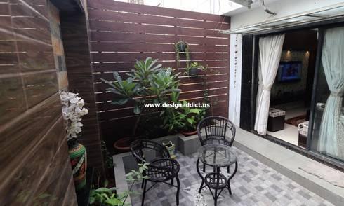 Row house interior designing work:  Balconies, verandas & terraces  by Designaddict