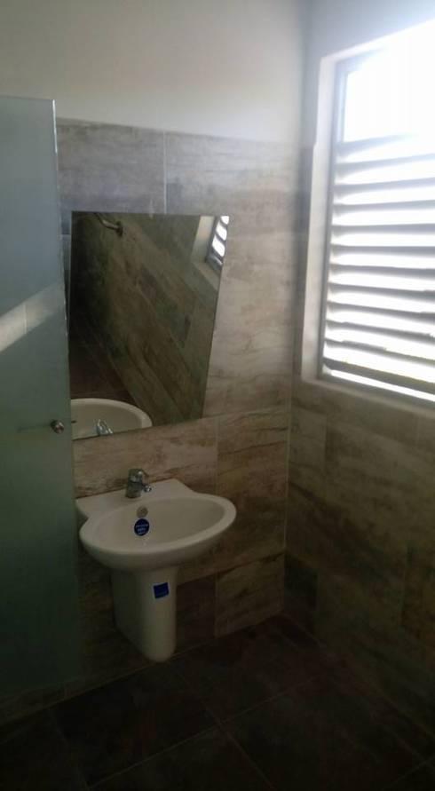 FEDEARROZ: Baños de estilo moderno por arquitectura sostenible ibague