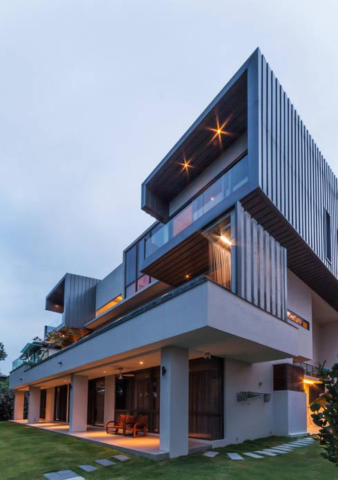 Rear Elevation - night: modern Houses by MJKanny Architect