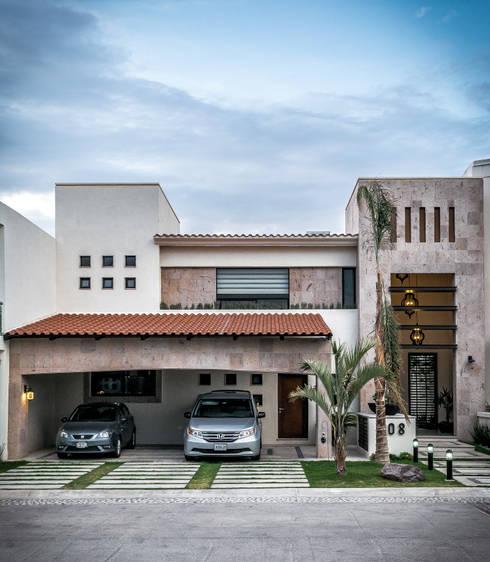 CASA T-108: Casas de estilo ecléctico por ARQDUO