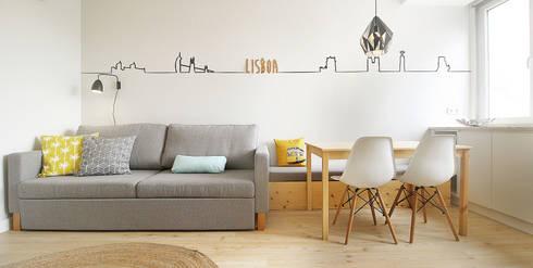 Apartamento da Alegria: Salas de jantar escandinavas por Homestories