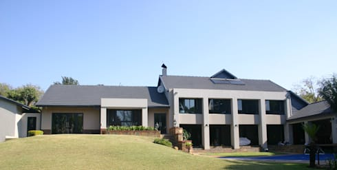 After photo of house from backyard:   by Nuclei Lifestyle Design