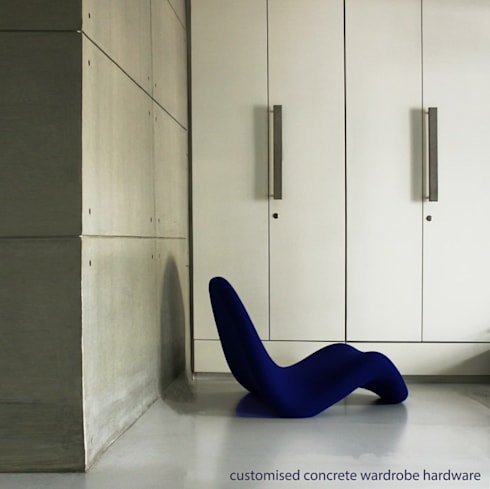 concrete wall and concrete wardrobe handle...: modern Dressing room by Design Paradigm