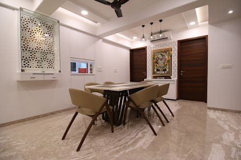 dining area close up: modern Dining room by Three Interiors