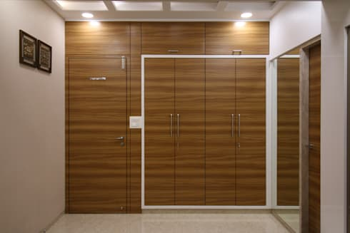 master bed wardrobe: modern Bedroom by Three Interiors