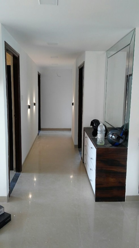 Mr. Udaybhan Singh Thakur Retirement Home:  Corridor & hallway by al-Haadi Interiors