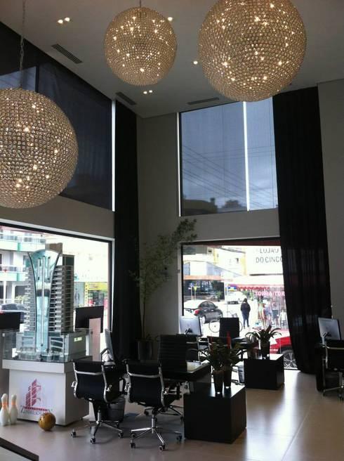 Térreo: Edifícios comerciais  por ALA Arquitetura e Interiores