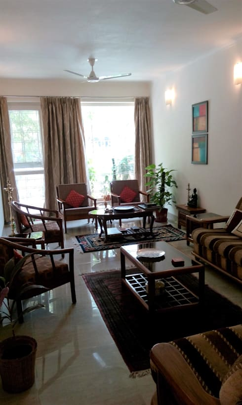 Old flat renovation:  Living room by Rennovate Home Solutions pvt ltd