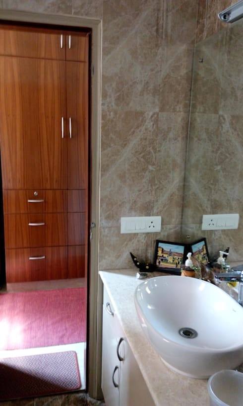 Old flat renovation: modern Bathroom by Rennovate Home Solutions pvt ltd