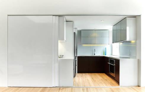 Sky Loft: modern Kitchen by KUBE Architecture