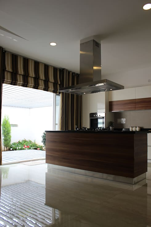 Garden Residence: modern Kitchen by Architecture Continuous