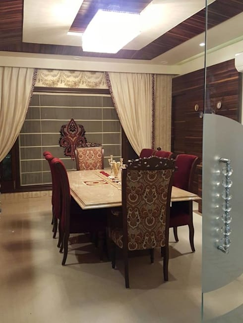 Interiors:  Dining room by Raheja Creations