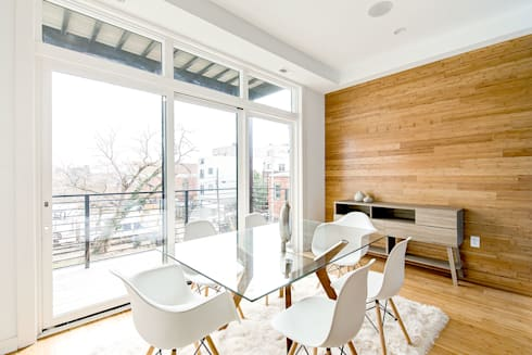 Divis Condo: modern Dining room by KUBE Architecture