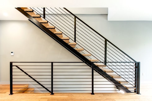 Divis Condo:  Stairs by KUBE Architecture