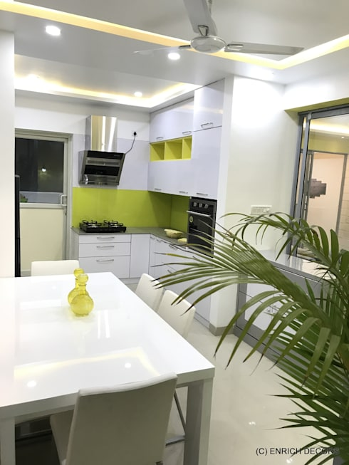 Dining and Kitchen View: modern Dining room by Enrich Interiors & Decors