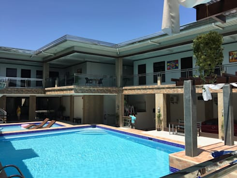 PRIVATE RESORT: minimalistic Houses by JGA INTERIORS