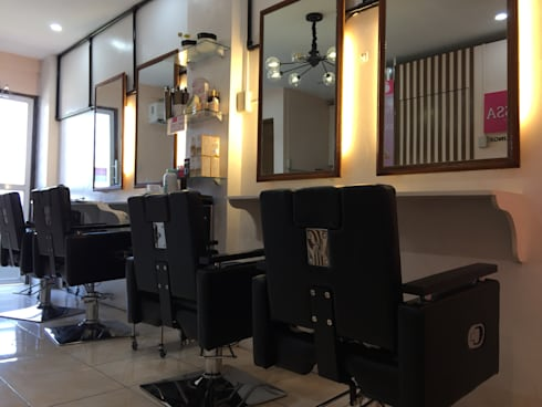 BEAUTY CENTER:  Office spaces & stores  by JGA INTERIORS