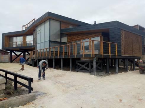 Vivienda Maria Salah: Casas de estilo moderno por Kimche Arquitectos