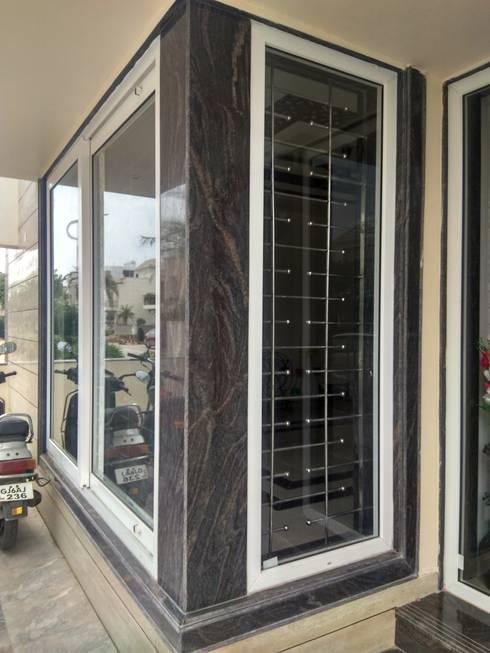 Granite Door and Window Sections:  Balconies, verandas & terraces  by Kapilaz Space Planners & Interior Designer