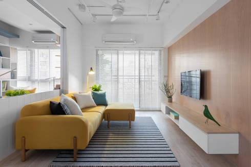 樂樂:  客廳 by 寓子設計