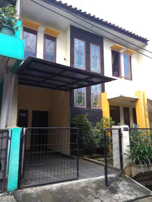 Renovasi pagar:   by Rumah Desain Tropis