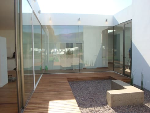 78_CasaMarbella_Vivienda: Casas unifamiliares de estilo  por Rakau Construcción + Arquitectura