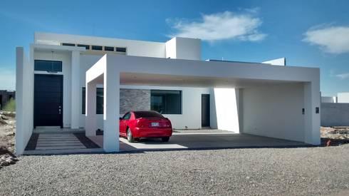 Casa Minimalista:  de estilo  por Guiza Construcciones