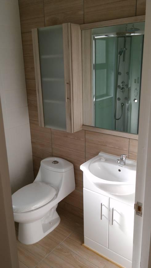Casa Gral.Cruz: Baños de estilo  por Lau Arquitectos