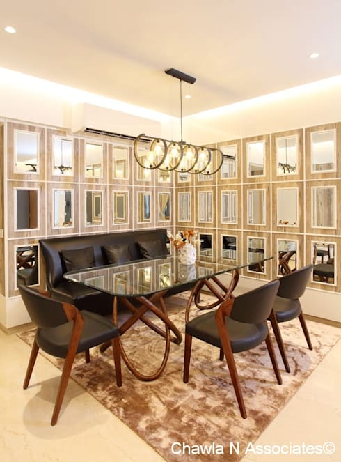 Dr.Bhavisha's Residence - Modern full interior renovation: modern Dining room by Chawla N Associates