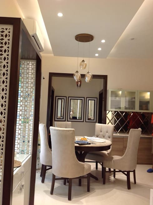 Residence at Astaire Gardens, Gurgaon: modern Dining room by INTROSPECS