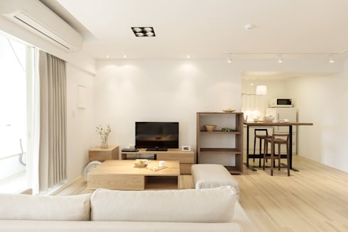 無印良品。輕暖宅:  客廳 by 文儀室內裝修設計有限公司